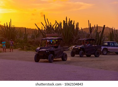 Aruba, Caribbean - January 13 2018: cars parked in the Cactus desert at sunset on the island of Aruba in the Caribbean Sea