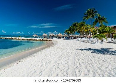 "Aruba, Caribbean - January 13 2018:   dreamy image of the most famous Caribbean beach ""Eagle Beach"" on the island of Aruba of the Netherlands Antilles known for its white sand and palm trees with"