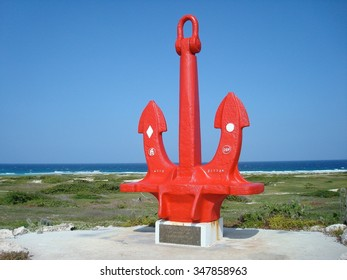 ARUBA, CARIBBEAN - MARCH 11, 2009: Ship anchor memorial to seamen near Boca Grandi Beach, Sea Grape Grove, Aruba, Caribbean