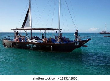 ARUBA - DEC 18, 2017 - Tourists aboard sightseeing schooner off the coast of Aruba
