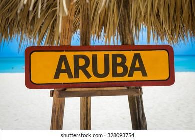 Aruba sign with beach background