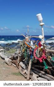 Aruba/NL - November 11, 2018: Ocean plastic trash arranged on the beach