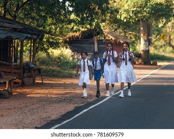 Arugam Bay, Sri Lanka - 10 May 2017: Children go to school by the side of the road.