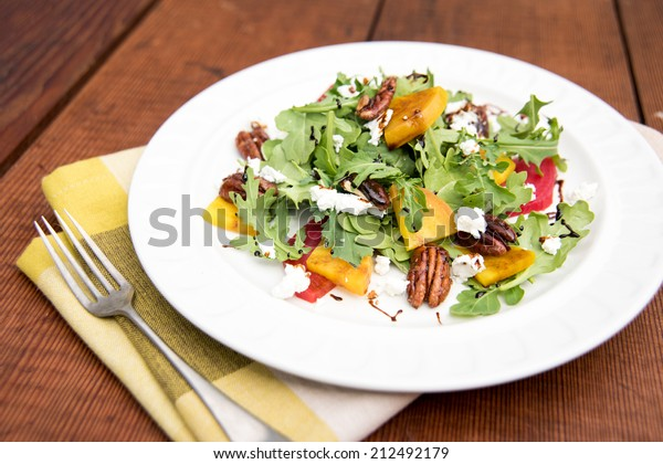 Arugula and Beet Salad with Goat Cheese and Candied Nuts