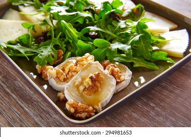 Arugula mediterranean salad with goat cheese honey and nuts