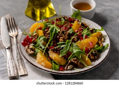 Arugula salad with oranges, walnuts and pomegranate.
