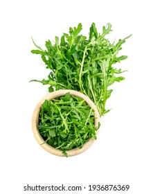 Arugula in wood bowl isolated. Fresh arugula, ruccola leaves, rucola, eruca or garden roquette salad top view