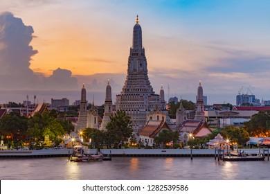 Arun temple river front with beauty sunlight sky background, Bangkok Thailand landmark