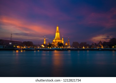 Arun Temple or Wat Arun, locate at along the Chao Phraya river with a colorful sky in Bangkok, Thailand