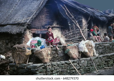 ARUN VALLEY, NEPAL - OCT 17, 1987 - Porters rest  their loads at a teahouse in the Arun Valley, Nepal, Asia