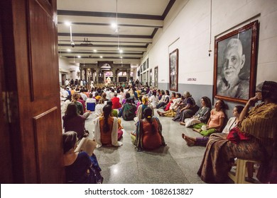 Arunachala, Tiruvannamalai / Tamil Nadu / India, January 22, 2018: Sri Ramana Maharshi Ashram interior with meditating visitors