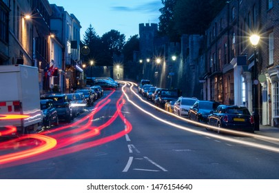Arundel High Street, England, night photo with car light trails. Arundel is a popular tourist attraction with a beautiful castle and impressive cathedral.