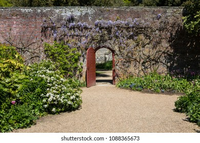 ARUNDEL, UK - MAY 5TH 2018: A doorway in the beautiful gardens at Arundel Castle in West Sussex, UK, on 5th May 2018.