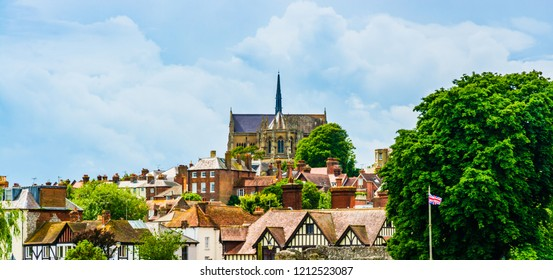 Arundel, UK: Skyline of the town with the Cathedral Church of Our Lady and St Philip Howard and houses' roof tops.