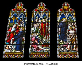 Arundel, United Kingdom - June 25, 2016: Religious colorful stained glass window in Arundel Cathedral, the Cathedral Church of Our Lady and St Philip Howard in Arundel, West Sussex, England, UK.