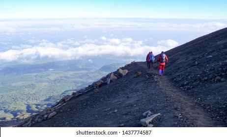 Arusha National Park, Kilimanjaro Province / Tanzania - 1. January 2016: climbers hike down from the summit of Mount Meru in Arusha National Park in Tanzania