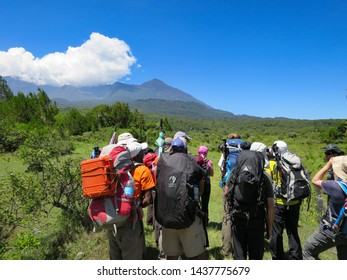 Arusha National Park, Kilimanjaro Province / Tanzania - 30. December 2015: mountain guides and climbers prepare to start climbing Mount Meru in Arusha National Park in Tanzania