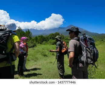 Arusha National Park, Kilimanjaro Province / Tanzania - 30. December 2015: An armed national park ranger instructs tourists about the dangers in Arusha National Park at the foot of Mount Meru