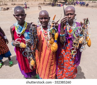 ARUSHA REGION, TANZANIA - OCTOBER 16, 2015: Maasai women offering souvenirs (mainly traditional jewelry) to the tourists in Arusha region, Tanzania, Africa.