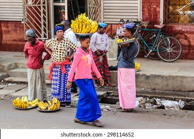 Arusha, Tanzania, Africa - January 2, 2013: A woman walks on her head carrying a bunch of bananas