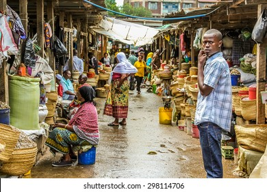 Arusha, Tanzania, Africa - January 2, 2013: Teenager on the road within  market of the town