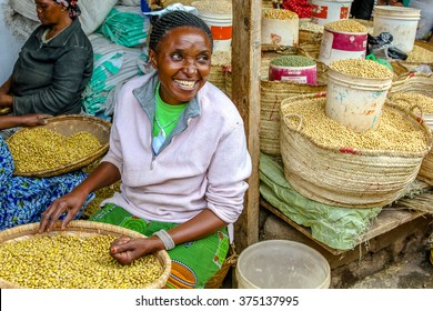 Arusha, Tanzania, Africa - January 2, 2013: Happy woman selling cereals at town market