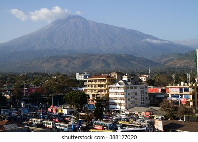 ARUSHA, TANZANIA - AUGUST 16: Arusha bus station in a busy day with the view of Mount Meru behind,   August 16, 2015 in Arusha, Tanzania