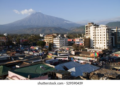 ARUSHA, TANZANIA - AUGUST 16: Arusha bus station and mount meru behind in a busy day,   August 16, 2015 in Arusha, Tanzania