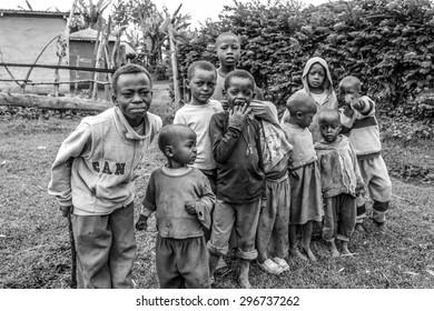 Arusha, Tanzania.- January 2, 2013: Children of Ilkidinga, Waarusha Masai village on the slopes of Mount Meru. Black and white.