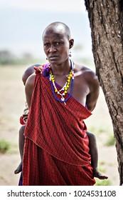 ARUSHA, TANZANIA - January 2018: African woman with child. African tribe Masai. Masai woman holding baby, Tanzania