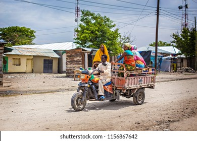 ARUSHA, TANZANIA - January 2018: African taxi with people. daladala with passengers on the road in Arusha, Tanzania
