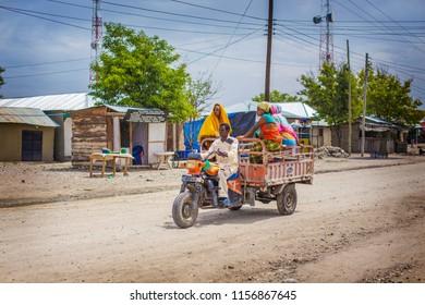 ARUSHA, TANZANIA - January 2018: African taxi with people. daladala with passengers on the road in Arusha, Tanzania