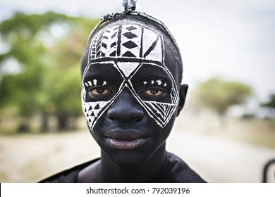 ARUSHA, TANZANIA - January 2018: Portrait of Masai warrior with traditional black and white face painting, Arusha, Tanzania