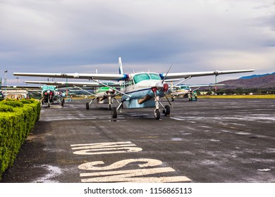 ARUSHA, TANZANIA - January 2018: Small propeller aircrafts on runway in Arusha airport, Tanzania