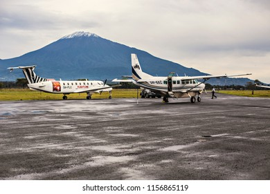 ARUSHA, TANZANIA - January 2018: Small propeller aircrafts on runway in Arusha airport, Tanzania