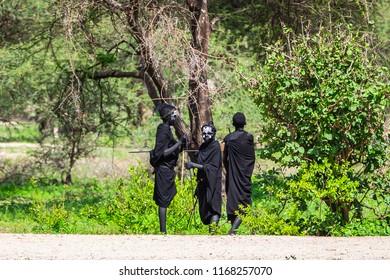 Arusha, Tanzania -January 24, 2018 - Traditionally  dressed Maasai waiting for  tourists near Arusha, Tanzania.