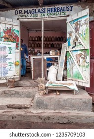 ARUSHA, TANZANIA - MAY, 2014 : Typical street scene in Arusha. Arusha is located below Mount Meru in the eastern branch of the Great Rift Valley and the capital of the Arusha Region.