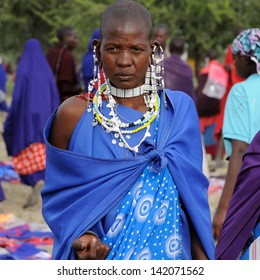 ARUSHA, TANZANIA - MAY 22: Masai woman tribe in Africa ethnic market with traditional jewellery, Arusha on May 22, 2013