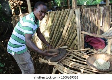 ARUSHA, TANZANIA - NOVEMBER 17: man roasting coffee in a traditional way in arusha tanzania 11.17, 2017 in Arusha, Tanzania