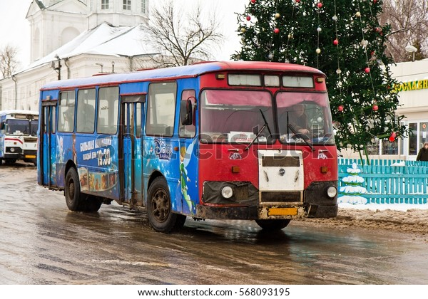ARZAMAS, RUSSIA - JANUARY 3, 2015. An old red soviet bus LiAZ-677 at bus stop in front of the Cathedral near the Christmas tree in Arzamas, Russia