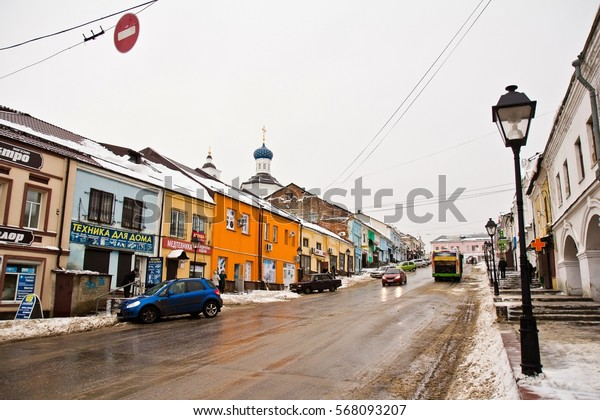 ARZAMAS, RUSSIA - JANUARY 3, 2015. Road with cars between colorful low houses in line in small city Arzamas, Nizhny Novgorod oblast, Russia