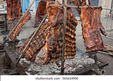 An asado is a roasted meat of beef or various other meats, which are cooked on a typical barbecue with vertical grills. It is a traditional dish in Argentina, Uruguay, Paraguay, Chile, and Brazil.