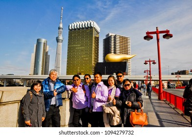 Asahi building, Tokyo, Japan  March 5 2015 : The educational group from Thailand  have been to Japan for  research  and visit  Asahi beer building.