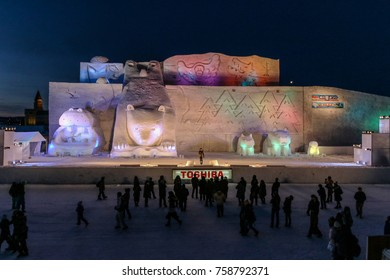 Asahikawa, Japan- February 10,2017 : a crowd enjoying the show and Snow sculptures with colorful lights by night in the pulic park in snow festival 2017 at winter ,Asahikawa,Hokkaido, Japan.