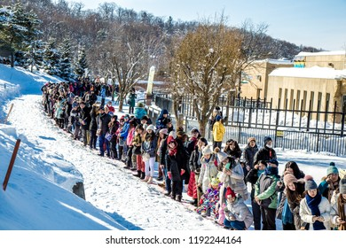Asahiyama Zoo, Asahikawa, Hokkaido, Japan - February 2018 : Penguins parade by outdoor walking exercise in every winter season with lot of tourist waiting to see the show