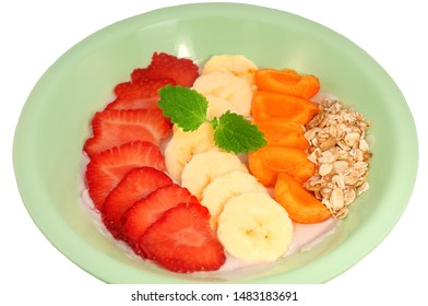 Asai Bowl in a plate with fruit and yogurt on a white background