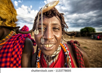 asai Mara - Kenya/ December 2017: portrait of a masai man wearing traditional dress and bright accessories during ritual dance.