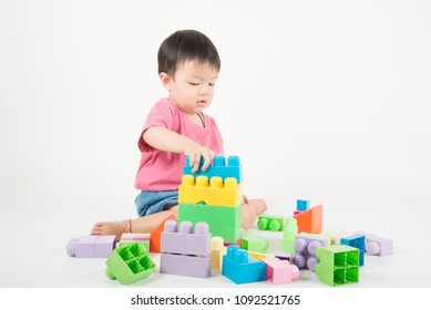 Asain baby Toddler 2 years old playing colorful blocks
