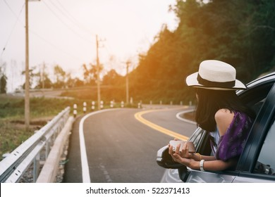 Asain woman traveler with hatchback car with beautiful mountain
