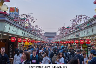 Asakusa, Japan - April 3, 2018: People around shopping street called Nakamise  at Asakusa shrine. Sensoji is Tokyo's most famous and popular temple. Built in the 7th century.